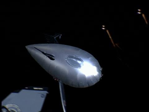 a model airship performs stunts in an aircraft hangar. - air vehicle stock videos & royalty-free footage