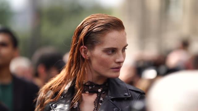 model alexina graham wears a black leather jacket, a black lace mesh top, a bag, outside balmain, during paris fashion week womenswear spring/summer... - mesh textile stock videos & royalty-free footage