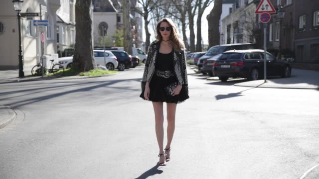 model and fashion blogger alexandra lapp wearing a black leather jacket from tigha decorated with studs and little spikes a vintage black petticoat... - skirt stock videos & royalty-free footage