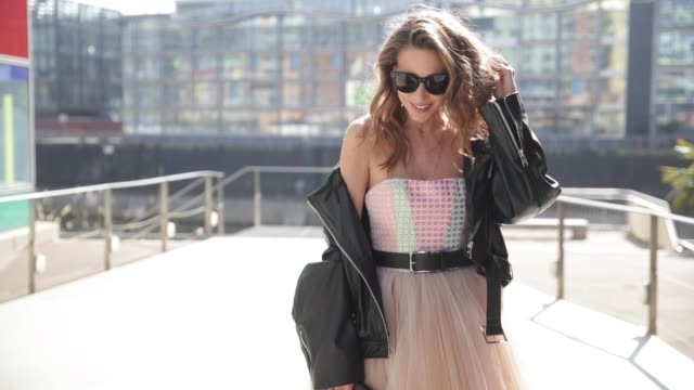 model and fashion blogger alexandra lapp wearing a multicolored sleeveless brocade tulle dress from natasha zinko a black biker leather jacket with... - tulle stock videos and b-roll footage