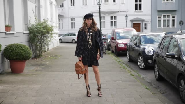 model and fashion blogger alexandra lapp wearing tweed dress and coat from steffen schraut balmain x hm sandals strak backpack by mcm chanel tweed... - earring stock videos & royalty-free footage