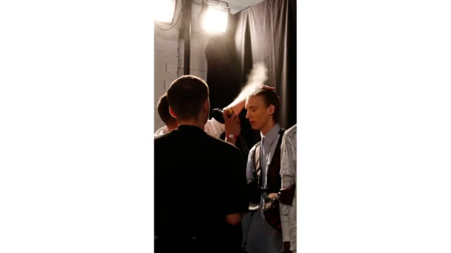 A model backstage ahead of the Studio ALCH show during London Fashion Week Men's June 2019 at the BFC Show Space on June 09 2019 in London England