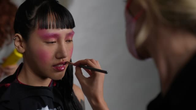model backstage has makeup artist wears a face mask ppe ahead of the lula laora show during lfw september 2020 at studio z, brixton on september 22,... - backstage stock videos & royalty-free footage
