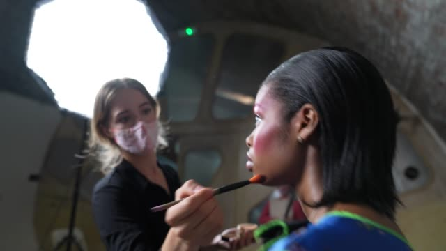 model backstage has makeup artist wears a face mask ppe ahead of the lula laora show during lfw september 2020 at studio z, brixton on september 22,... - design stock videos & royalty-free footage