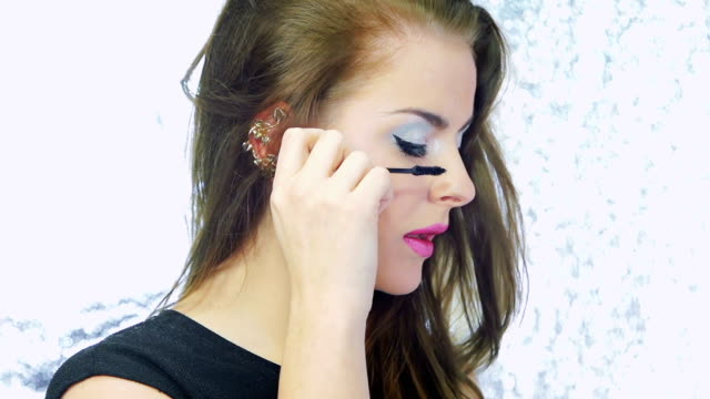 model brushing her eyebrow - stage make up stock videos and b-roll footage