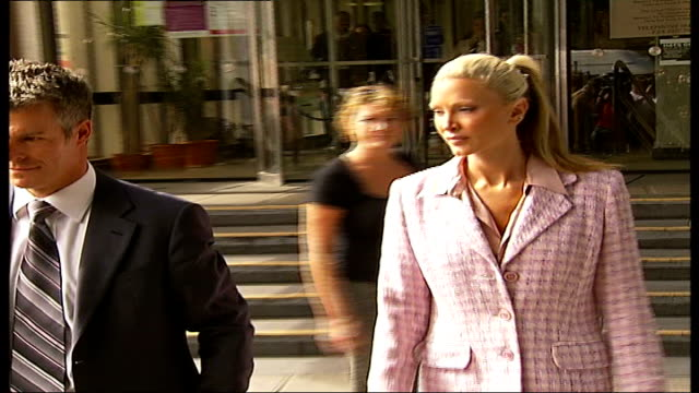 model caprice drink driving charge; england: london: highbury corner magistrates court: ext caprice and nick freeman along outside court to press... - caprice bourret video stock e b–roll