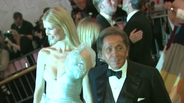 "model claudia schiffer and designer valentino garavani at the ""superheroes: fashion and fantasy"" costume institute gala at the metropolitan museum of... - valentino designer label stock videos & royalty-free footage"