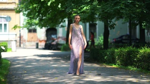 model cristina padure wears a purple lace mesh dress from cindyalan, during feeric fashion week 2018, on july 21, 2018 in sibiu, romania. - mesh textile stock videos & royalty-free footage