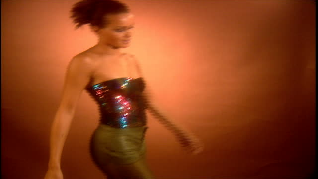 model dancing and walking in multi colored sequins camisole and gold pants - camisole stock videos & royalty-free footage