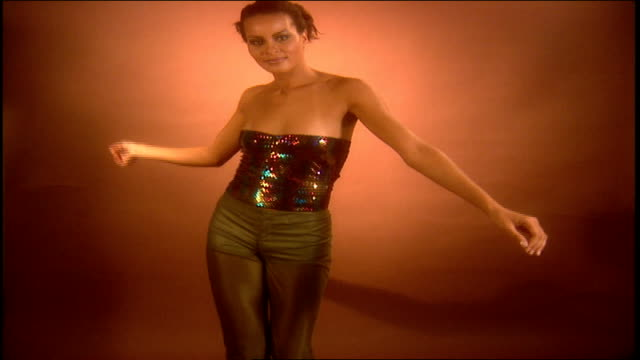 model dancing in multi colored sequins camisole and gold pants - camisole stock videos & royalty-free footage