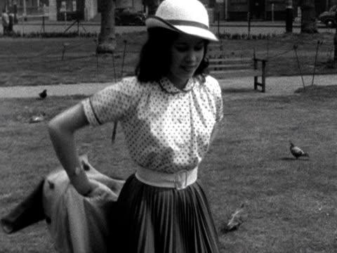 vídeos de stock e filmes b-roll de a model demonstrates a reversible coat - saia