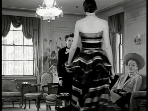 model displaying elegant tube top stripe dress to customers sitting on couch ms new yorkers husband wife on couch examining dress on model bergdorf... - bergdorf goodman stock videos and b-roll footage