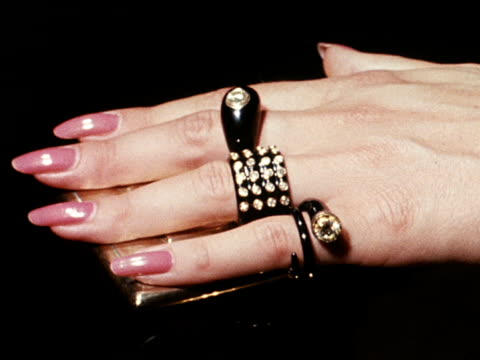a model displays rings and bracelets designed by marc bohan for house of dior - precious gemstone stock videos & royalty-free footage