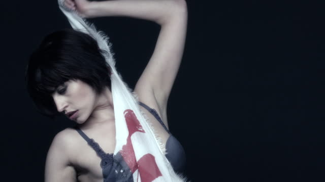 A model drapes herself with an American flag at a photo shoot in Germany.