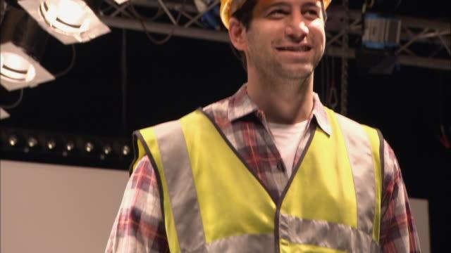 cu td model dressed as construction worker standing on catwalk as people clap/ london, england - この撮影のクリップをもっと見る 1064点の映像素材/bロール