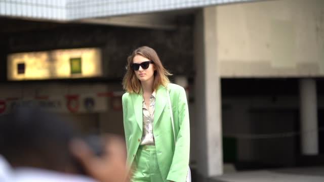 model emmy rappe wears a green suit blazer jacket flard pants vuitton sneakers shoes outside acne during paris fashion week menswear springsummer... - completo video stock e b–roll
