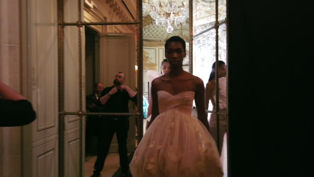 model enters backstage from the runway during the rami al ali haute couture presentation spring/summer 2020 as part of paris fashion week on january... - backstage stock videos & royalty-free footage
