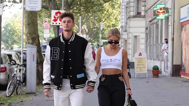 model fabian arnold wearing a black and white college jacket by barbeux, a black tank top by merlino street, white denim jeans pants by american... - メルセデスベンツファッションウィーク点の映像素材/bロール