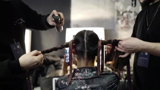 berlin germany january 15 a model gets prepared backstage ahead of the lena hoschek show during berlin fashion week autumn/winter 2020 at kraftwerk... - gif stock videos and b-roll footage