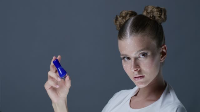 model handles blue nail polish and shows facial expressions. fashion video. - greasepaint stock videos and b-roll footage