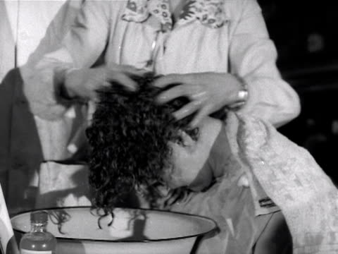 a model has her hair vigorously washed during a hairdressing competition 1953 - washing hair stock videos & royalty-free footage