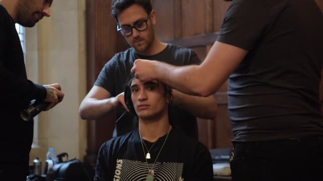a model has his hair made up backstage during london fashion week menswear on january 8 2018 in london england - hair spray stock videos & royalty-free footage