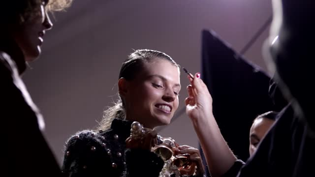 model has their makeup touched up by an artist backstage ahead of the next gen show during afterpay australian fashion week 2021 resort '22... - carriageworks stock videos & royalty-free footage