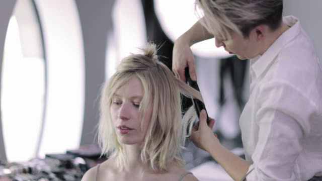 model having hair styled on a photoshoot - hairdresser stock videos & royalty-free footage