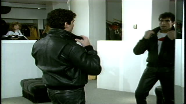cu model in black leather jacket with collar up - leather jacket stock videos and b-roll footage