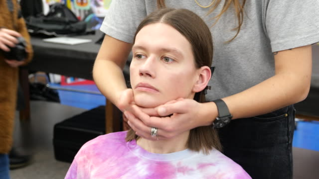 model in hair and makeup is seen at arthur arbesser backstage on february 19, 2020 in milan, italy.. - skin care stock videos & royalty-free footage