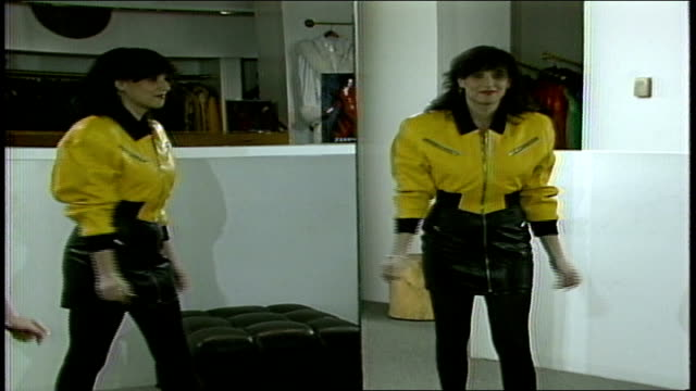 Model in Yellow Leather Outfit and Black Skirt Looking into Mirror