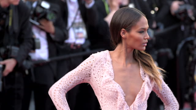 model joan smalls posing for paparazzi on both sides of the red carpet at the grand theater lumiere - joan smalls stock videos & royalty-free footage