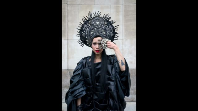 Model Lily Gatins shows her extraordinary outfit during Paris Fashion Week on March 2 2018 in Paris France