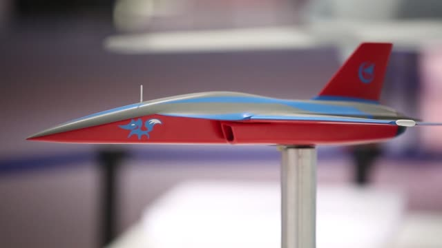 a model of a blue fox highmaneuverability drone from aviation industry corp of china stands on display during the china international aviation... - tail wing stock videos and b-roll footage