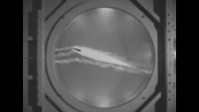 model of airplane sitting on stand inside wind tunnel its propeller spinning / small pieces of fabric on plane fluttering in wind / three pov shots... - aircraft wing stock videos & royalty-free footage