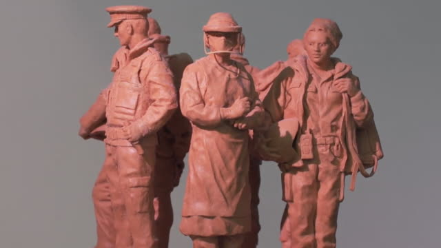 """model of planned statue for national emergency services memorial - """"bbc news"""" stock videos & royalty-free footage"""