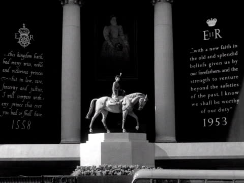 A model of Queen Elizabeth riding a horse above the main entrance to Selfridges on Oxford Street in preparation of her coronation 1953