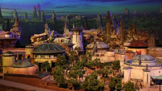 galaxy's edge themed area being developed at disneyland park is displayed at the d23 expo 2017 in anaheim california us on saturday july 15 2017... - star wars stock videos & royalty-free footage