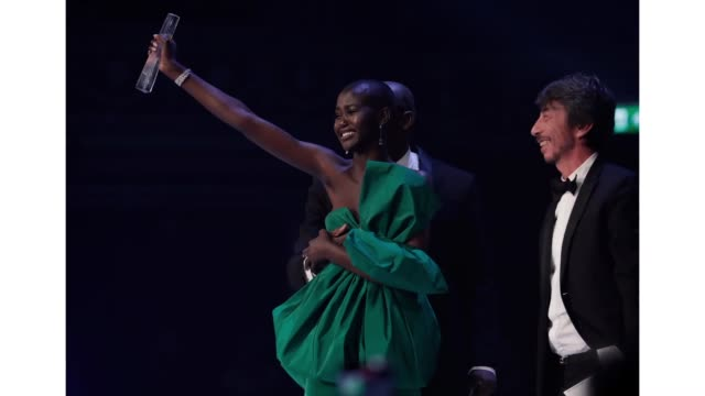 model of the year adut akech accepts her award on stage from edward enninful and pier paolo piccioli during the fashion awards 2019 held at royal... - award stock videos & royalty-free footage