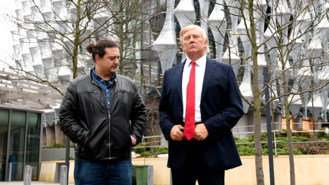 a model of us president donald trump from the madame tussaud's waxwork attraction stands outside the new us embassy on january 12 2018 in london... - us embassy stock videos & royalty-free footage