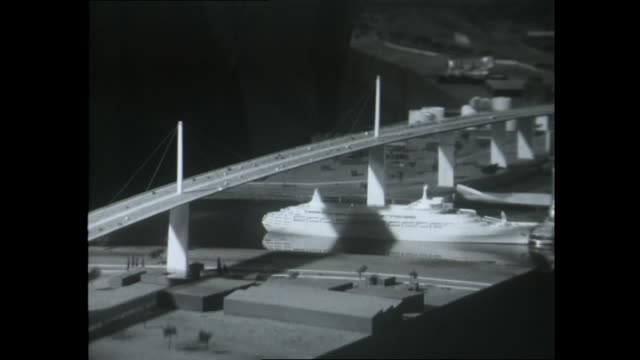 model of yarra river bridge now known as westgate bridge with model boat underneath / pylon construction stack of concrete blocks / meter reading /... - pile driver stock videos & royalty-free footage