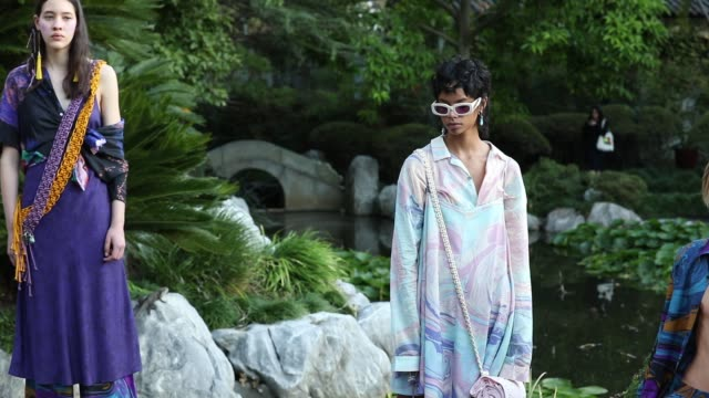 vídeos de stock, filmes e b-roll de a model poses during the double rainbouu show at mercedesbenz fashion week resort 20 collections at the chinese garden of friendship on may 15 2019... - andrew mathers