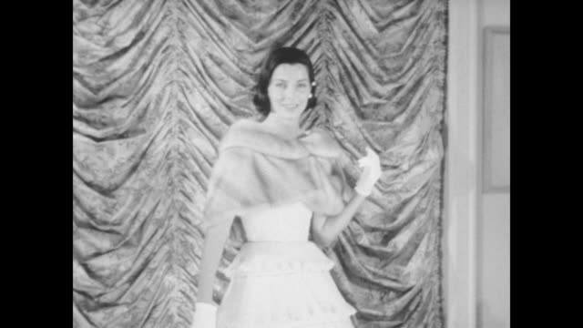 model poses in formal dress and fur wrap by designer helena barbieri / models in several long cocktail and evening dresses with lace and pleats... - wrap dress stock videos and b-roll footage