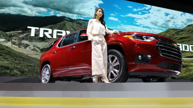 a model poses next to a gm traverse at the seoul motor show 2019 at kintex on march 28 2019 in goyang south korea - goyang stock videos and b-roll footage