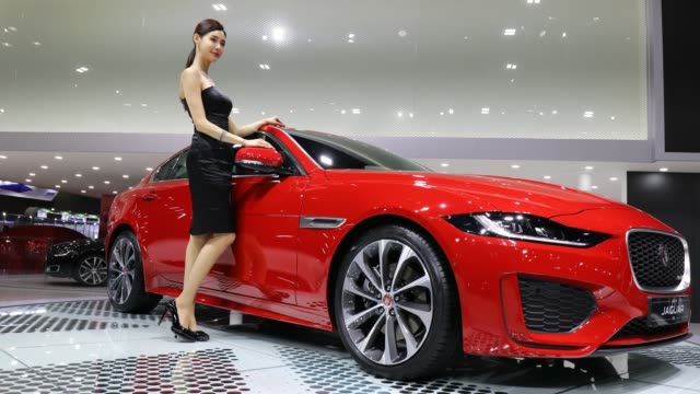 a model poses next to a new jaguar at the seoul motor show 2019 at kintex on march 28 2019 in goyang south korea - goyang stock videos and b-roll footage