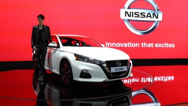 a model poses next to a nissan altima at the seoul motor show 2019 at kintex on march 28 2019 in goyang south korea the seoul motor show 2019 will be... - goyang stock videos and b-roll footage