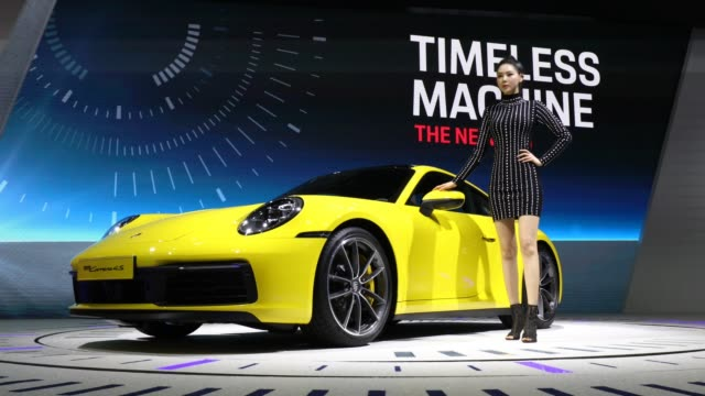 a model poses next to a porsche 911 at the seoul motor show 2019 at kintex on march 28 2019 in goyang south korea the seoul motor show 2019 will be... - goyang stock videos and b-roll footage