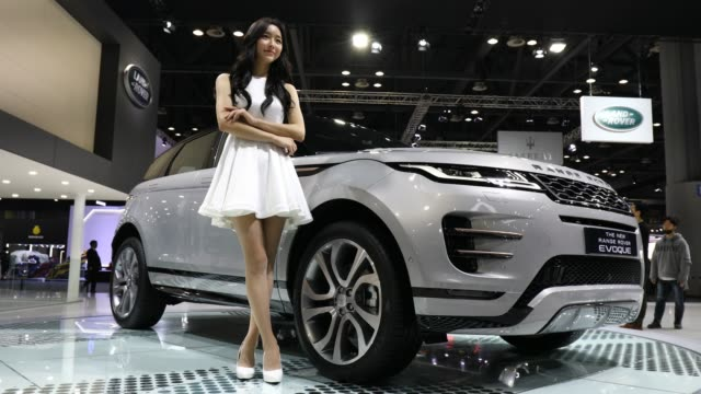 a model poses next to a range rover evoque at the seoul motor show 2019 at kintex on march 28 2019 in goyang south korea - goyang stock videos and b-roll footage