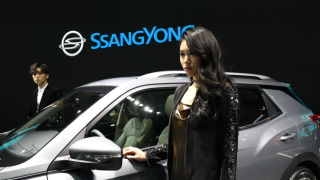 a model poses next to a ssangyong korando at the seoul motor show 2019 at kintex on march 28 2019 in goyang south korea the seoul motor show 2019... - goyang stock videos and b-roll footage