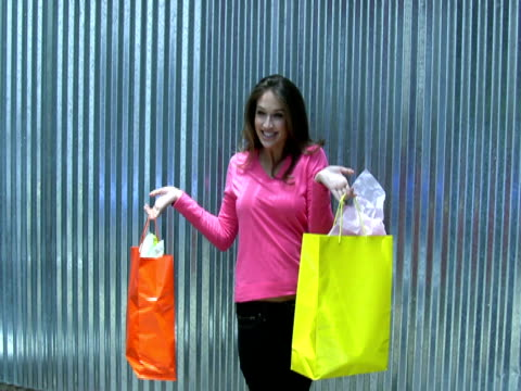 Model Poses with Shopping Bags under Sun Shade